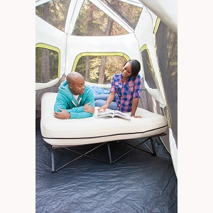 Elevated Coleman Queencot with Air Mattress for home use or camping fun.